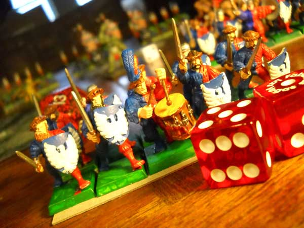 Miniature soldiers, drummer, and dice